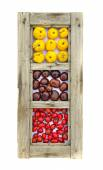 Healthy fruits and conkers in old wooden window frame isolated — Stock Photo