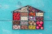 Vegetarian healthy fruits, seeds and dried food ingredient in wooden box — Foto Stock