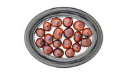 Conker fruits seeds chesnuts in  picture oval frame isolated  — Stock Photo