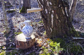 Pitcher jug and birch tree with spigot and sap drops — Stock Photo