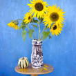 Beautiful summer sunflowers in old ceramic vase — Stock Photo #68454725