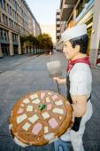 Berlin - Germany - September 27 :Funny commercial pizzaman statue made of plastic is located in the center of Berlin city  - Germany. — Foto de Stock