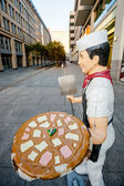 Berlin - Germany - September 27 :Funny commercial pizzaman statue made of plastic is located in the center of Berlin city  - Germany. — Stock Photo