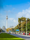 Berlin - Germany - September 27. Car is going down the street named Karl-Marx-Strasse in Berlin - one of the widest streets in east Berlin. Tv tower in background — Stockfoto