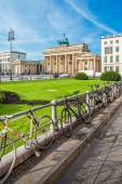 Berlin - Germany  - September 29 : People walks on Parisen Platz (Paris Square)  next to Brandenburg Gate in Berlin, Germany. Bicycles are locked to the steel fence around the square. — Stock Photo