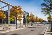 Berlin - Germany  - September 29, 2014.Sigle bicyclist rides along the Bundestag building -  sunny autumn view of the modern building of Bundestag - German Government offices in Mitte district — Stock Photo