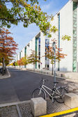 Berlin - Germany - September 29, 2014 .Single bicycle is locked next to the Bundestag building - sunny autumn view of the modern building of Bundestag - German Government offices in Mitte district. — Stock Photo
