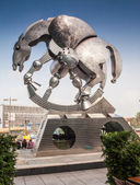 "Berlin, Germany - October 01, 2014. Overview of the scultpure named ""Rolling Horse"" located near the Main Railway Station in Berlin, Germany. Sculpture was designed by the sculptor Jurgen Goertz. — Foto de Stock"