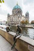 Berlin - Germany - October 02. Berlin Cathedral (Berliner Dom) and nude sculptures - three girls and a boy. Berlin - Germany - October 02, 2014 — Stock Photo