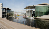 Berlin - Germany - September 28.  Two tourists ships floats on the river Spree next to a modern buildings of Bundestag and Marie-Luders-Haus. Berlin - Germany - September 28, 2014. — Stock Photo