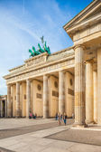 Berlin - Germany - September 29.  Tourists walk around Brandenburg Gate  - main most known monument in Berlin. Berlin - Germany - September 29, 2014 — Stock Photo