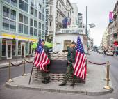 "Berlin - Germany - September 30.  Two bored ""US soldiers"" - two actors playing the role of US soldiers at historical Checkpoint Charlie in Berlin city. Berlin - Germany - September 30, 2014 — Stock Photo"