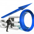 Businessman standing over a seo symbol — Stock Photo #67732913