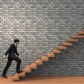 Businessman climbing on steps — Stock Photo