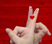 Two hand fingers with a heart — Stock Photo
