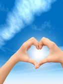 Heart over blue sky background — Stock Photo
