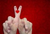 Fingers and a heart painted — Stock Photo