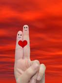 Two fingers painted with a red heart — Stock Photo