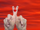 Fingers painted with a red heart — Stock Photo