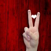 Fingers with a heart painted — Stok fotoğraf