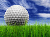 Grass over a blue sky background with a golf ball at horizon — Stock Photo