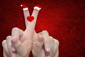 Fingers in love with Christmas hats — Stock Photo