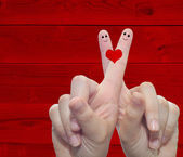 Hands fingers with a heart painted — Stock Photo