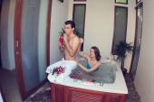 Honeymoon. Newlyweds in hotel in a jacuzzi — Stok fotoğraf