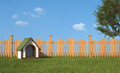 Kennel on grass in the garden — Stock Photo