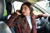 Woman driving a car talking on the phone — Stock Photo