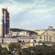 Panorama of a cement plant in a sunny summer afternoon — Stock Photo #60475027