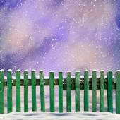 Snowy old green wooden fence and falling snow — Foto de Stock