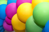 Multicolored balloons closeup as background — Stockfoto