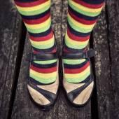 Female legs in striped socks in vintage style — Stock Photo
