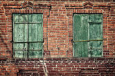 Old window with closed shutters on a brick wall — Stock Photo