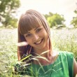 Young beautiful girl lying on the grass — Stock Photo #75389005