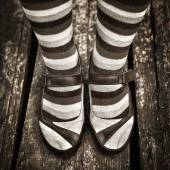 Black and white Female legs in striped socks in vintage style — Stock Photo