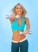 Athletic young lady doing workout with weights — Stock Photo