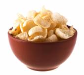 Potato chips in a bowl isolated on white — Stock Photo
