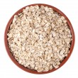 Hercules (oat flakes) in a bowl isolated on white background — Stock Photo #63818441