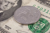 Currency exchange. Russian ruble coin lies on a banknote two dollars US — Stock Photo
