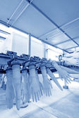 Acrylonitrile butadiene gloves production line in a factory, nor — Stock Photo