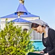 Woman reading an orthodox book — Stock Photo #57705023