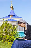 Woman reading an orthodox book — Stock Photo