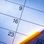 Pencil lying on a calendar — Stock Photo #53716931