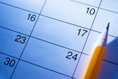 Pencil lying on a calendar — Foto Stock