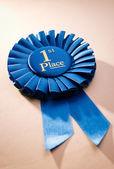 Blue first place winner rosette — Stock Photo