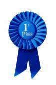 Circular pleated blue winners rosette — Stock Photo