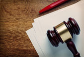Wooden judges gavel and blank paper — Stock Photo