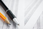 Pen and Pencil on Top of Business Documents — Stock Photo